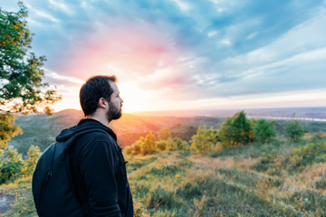 Man enjoying mountain sunset