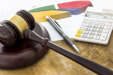 Labor law concept, laptop, gavel, calculator and money on wooden table