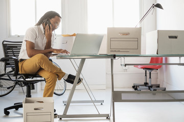 Black businessman working in new office