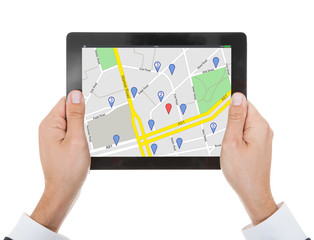 Person's Hand With Digital Tablet Showing Marker Location Icon