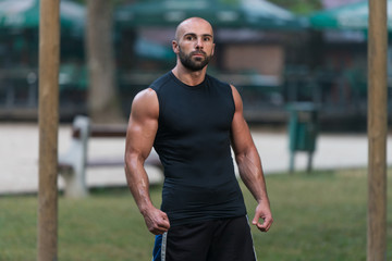Portrait Of A Bodybuilder Posing Outdoors