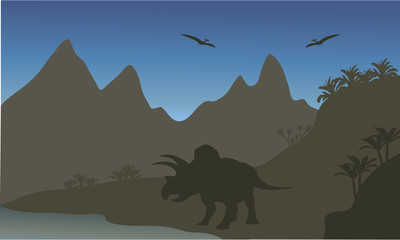 Silhouette of pterodactyl and triceratops