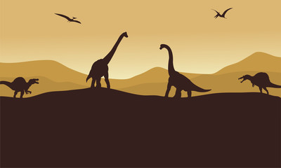 Silhouette of many dinosaur in hills