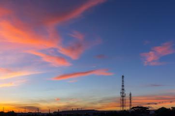 Sky with silhouettes of radio antenna.