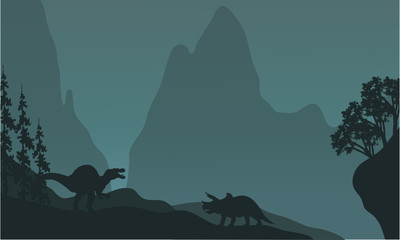 Silhouette of triceratops and spinosaurus