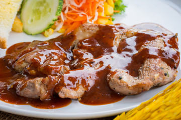 Beef steak with black pepper sauce , salad and French fries on s