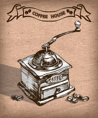 Vintage hand drawn coffee mill with coffee beans. Sketch style. Vector illustration