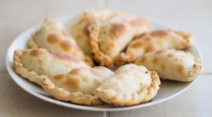 side view of a plate of empanadas