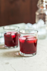 two glasses of fruit drink blackcurrant