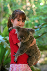 Little girl holding a Koala