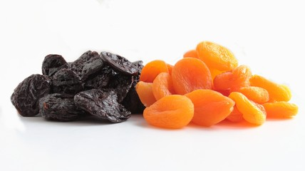 Dried prunes and apricots fruits isolated on white background
