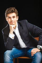 Fashion young businessman black suit