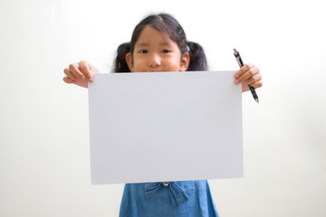 little girl holding a white paper