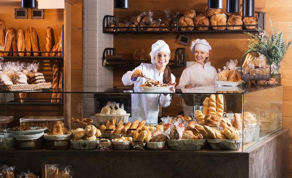 Bakery staff offering bread