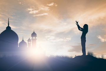 Silhouette of woman pray, religion concept