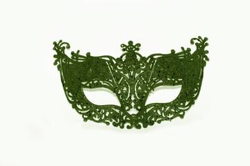 Beautiful green face mask on white studio background (wallpaper)