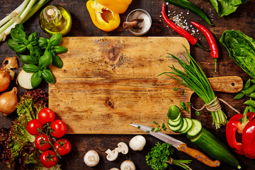 Cutting Board and Knife with Vegetables on Table Wall mural