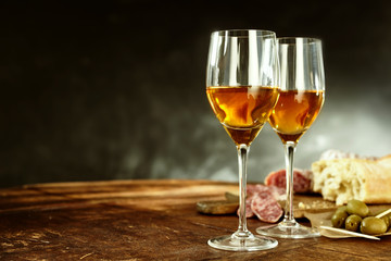 Two glasses of sherry with tasty tapas
