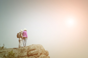 Young couple standing top of the mountain ,Travel concept