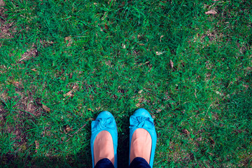 Foot standing on the Grass seen from Above, Free Space for Text