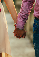 Close-up of lovers'?? hands holding each other