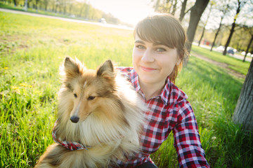 young woman taking selfie with her dog