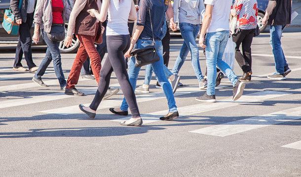 pedestrians walking on a crosswalk
