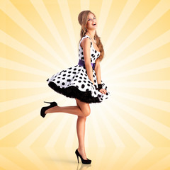 Lady in dots / Creative vintage photo of a smiling pin-up girl wearing a retro polka-dot dress on colorful abstract cartoon style background.