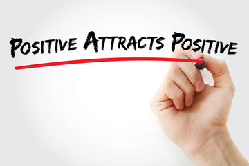 Hand writing Positive Attracts Positive with marker, health concept background