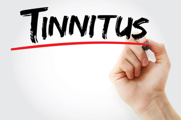 Hand writing Tinnitus with marker, health concept background
