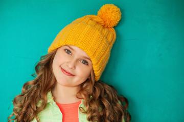 Beautiful little lady in yellow woolen cap