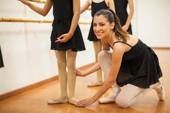 Beautiful Hispanic dance teacher at work