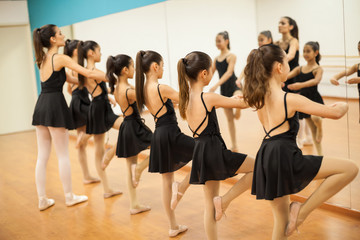Group of girls and teacher in a dance academy