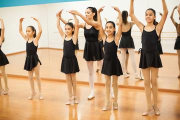 Cute girls enjoying their dance class