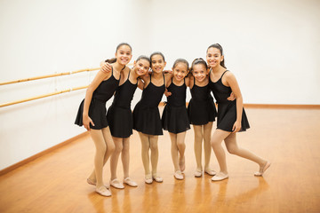 Happy little dancers in a ballet class