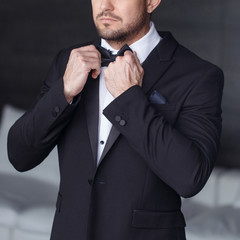 Sexy man dressing tuxedo and suit closeup