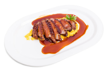 Grilled duck breast on mango puree.