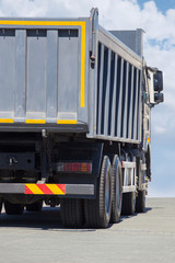 dump truck goes  on highway