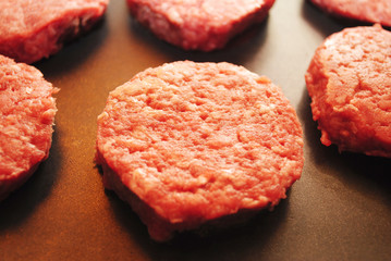 Slider Hamburgers Cooking on a Griddle