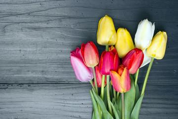 tulip bouquet on dark wooden background