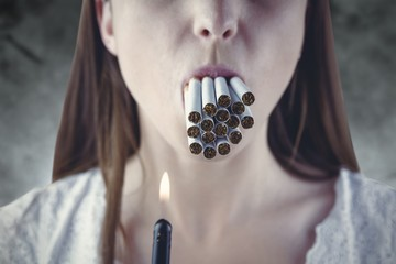 Composite image of woman lighting many cigarettes in mouth