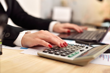 businesswoman considers profit