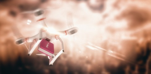 Composite image of digital image of a drone holding a cube