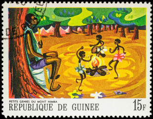 Little black girls dancing around the fire - scene from African