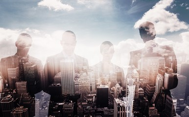 Composite image of business colleagues using their multimedia de