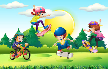 Children skateboarding and riding bike in park
