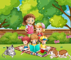 Children reading books in the garden