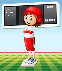 Girl in baseball outfit in the field