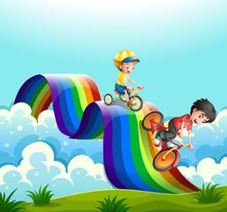 Kids riding bike over the rainbow