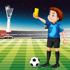 Referee showing yellow ticket in football field